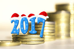 The numbers 2017 in the background of bars coins . The concept of financial stability in the new year Stock Images