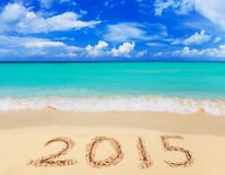 Numbers 2015 on beach. Concept holiday background Stock Photography