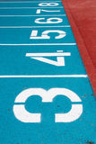Numbers of blue running track Royalty Free Stock Photography