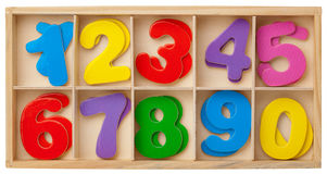 Numbers in a box. Isolated. Color cards with numbers in a wooden box. Isolated on white background stock illustration