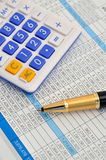 Numbers calculation. Ball pen and calculator on a number paper, means working, information, analysis, data storage or result or key and important data Royalty Free Stock Photography