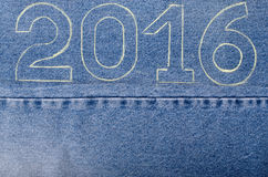 Numbers 2016 of chalk contour on the background of the jeans. Ch Stock Photo