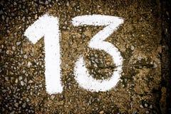 Numbers on the concrete floor. Stock Photos