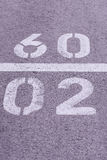 Numbers in concrete. Number painted on concrete two and nine Stock Image