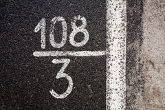 Numbers and digits on the asphalt Royalty Free Stock Photography