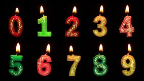 Numbers in the form of candles. On a black backgraund stock video