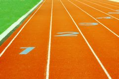 Numbers game. Stadium with track and field showing starting line Royalty Free Stock Photos
