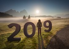 2019 numbers with girl looking forward to future Royalty Free Stock Photos