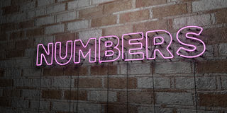 NUMBERS - Glowing Neon Sign on stonework wall - 3D rendered royalty free stock illustration Royalty Free Stock Images