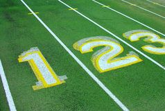 Numbers on green track. Royalty Free Stock Images
