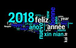 2018 greeting card on black background, new year translated in many languages. 2018 numbers greeting card on black background, new year translated in many Royalty Free Stock Photo