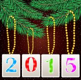 Numbers 2015 hang on the branches of christmas tree Stock Photography