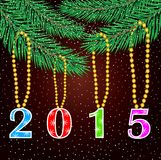 Numbers 2015 hang on the branches of christmas tree Royalty Free Stock Image
