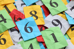 Numbers Heap. Heap of Crumpled colorful paper notes with numbers. Close-up royalty free stock photos