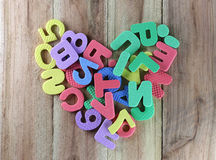 The numbers and letters arranged in a shape heart. Stock Image