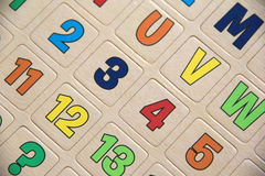 Numbers and letters on tan background Stock Photo