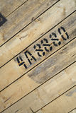 Numbers and letters written with paint on wood. Royalty Free Stock Photography