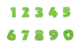 Numbers made of green grass  on white Royalty Free Stock Images