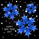 2017 numbers of new year and snow. Happy New Year 2017. Numbers 2017 with blue snowflakes and snow on a black gradient background. Inscription 2017 and blue royalty free illustration