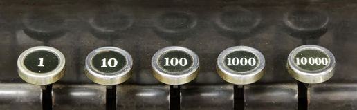 Numbers on an old typewriter reflecting Stock Photography