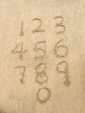 Numbers from one to ten written on sand Royalty Free Stock Photography