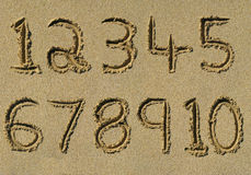 Numbers one to ten written on a sandy beach. Royalty Free Stock Photography