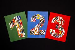 Numbers One, Two, Three made from numbers cutting from magazines. On black background Stock Image