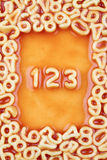 Numbers One, Two and Three in Tomato Pasta Sauce Royalty Free Stock Images