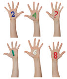 Numbers painted on children hands.  Rises up hands. Royalty Free Stock Image