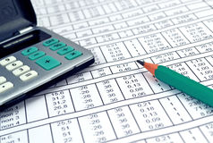 Numbers on paper and calculator Royalty Free Stock Photography