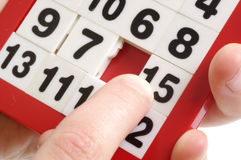 Numbers puzzle and finger Stock Images