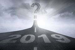 Numbers 2019 with question mark on road royalty free stock image