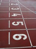 Numbers on Red Race Track. Running tracks on a track field, shot of numbered lanes on the track numbers from 1-6 Stock Images