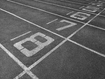 Numbers on running track background Stock Photo