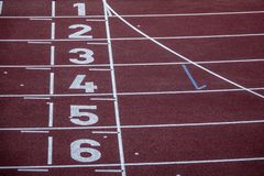 Numbers on a running track. Empty sports arena stock photos