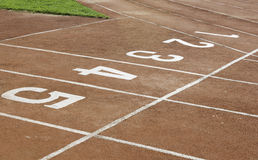 Numbers on running track. Start and Finish point of race track stock photo