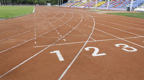 Numbers on running track. Start point of race track stock image