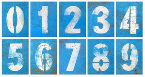 Numbers series on a blue wall Royalty Free Stock Image
