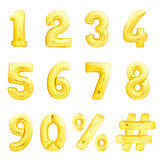 Numbers set, hashtag, percent. Golden inflatable balloons. Golden numbers set, hashtag, percent sing made of golden inflatable balloons Stock Images