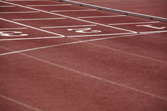 Numbers signpost in an athletic running track Stock Photo