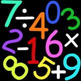Numbers and signs. Colorful maths numbers and signs on black background Stock Photo