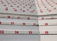 Numbers on the stadium bleachers. Many numbers on the stadium bleachers to indicate a seat stock photo