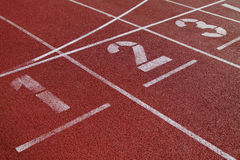 Numbers on the start of a running track Stock Photo