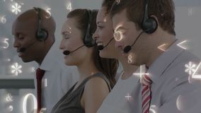 Numbers, symbols and call centre agents. Digital composite of male and female call centre agents working. Numbers and symbols can be seen moving in the stock footage