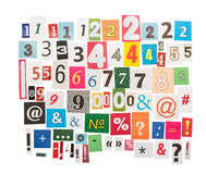 Numbers and symbols from newspapers Royalty Free Stock Images