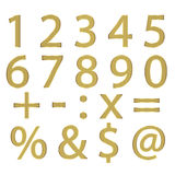 Numbers and symbols. A series of simple numbers, and symbols, embroidered with gold thread on a white field Stock Photo