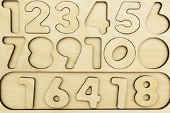 Numbers from 1 to 9 cut out on a wooden board stock photography