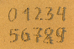 Numbers from 0 to 9 drawn on the sand to the sea. Education. Numbers from 0 to 9 drawn on the sand to the sea Stock Photos