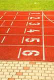 Numbers of tracks. Red running racetrack on the outdoor athletic stadium Stock Photo