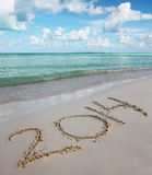 Numbers 2014 on Tropical Beach. Holiday concept of New Year Royalty Free Stock Photos